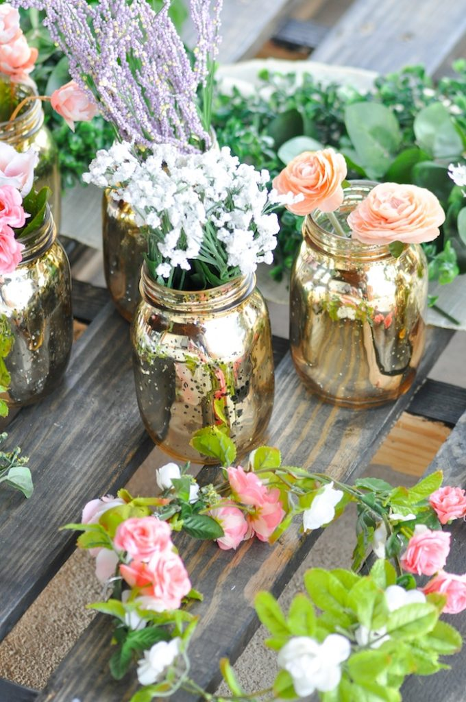 Flowers in DIY mercury vases from DIY Floral Strung Balloon Garland via Kara's Party Ideas