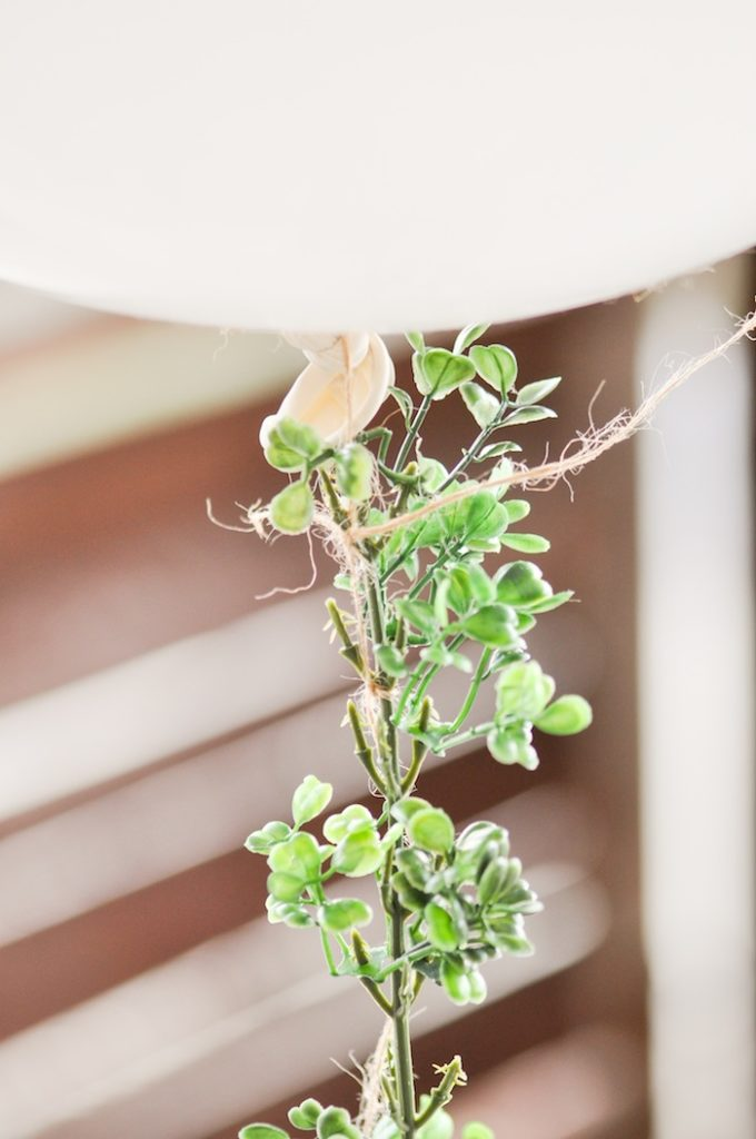 Large Balloon and Green Garland from DIY Floral Strung Balloon Garland via Kara's Party Ideas
