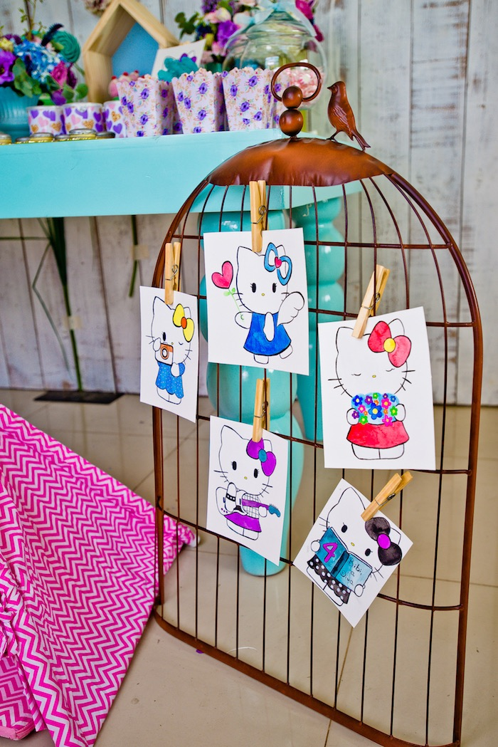 Hello Kitty prints attached to wire bird cage frame from a Floral Hello Kitty Birthday Party on Kara's Party Ideas | KarasPartyIdeas.com (30)