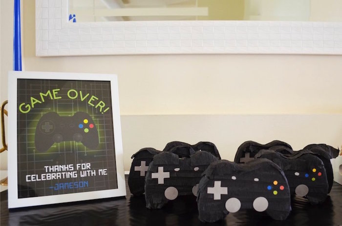 Game controller favor pinatas from a Gaming + Video Gamer Birthday Party on Kara's Party Ideas | KarasPartyIdeas.com (9)