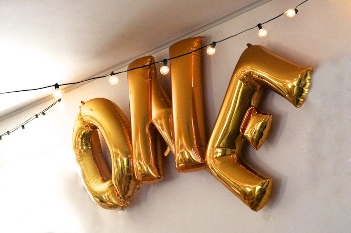 """One"" mylar letter balloon banner from a Minnie Mouse Inspired ""Wild One"" Birthday Party on Kara's Party Ideas 