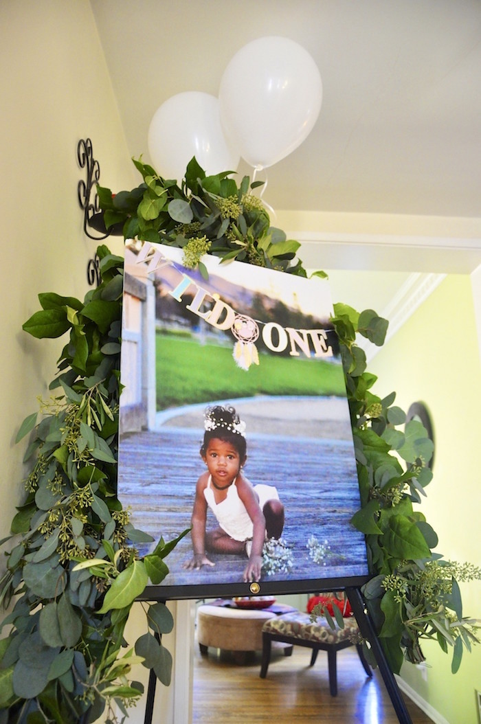 "Photo canvas bordered with greenery from a Minnie Mouse Inspired ""Wild One"" Birthday Party on Kara's Party Ideas 