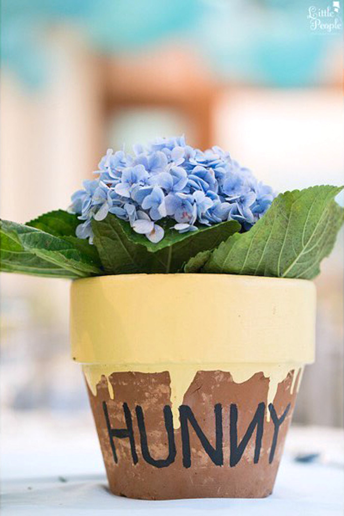 """Hunny"" pot flower centerpiece from a Winnie the Pooh Birthday Party on Kara's Party Ideas 
