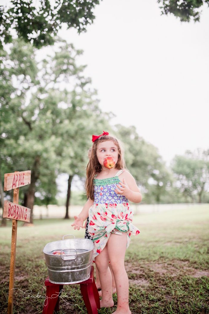 Apple Bobbing from a Farmer's Market Birthday Party on Kara's Party Ideas | KarasPartyIdeas.com