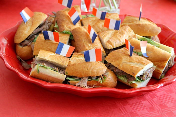 "Sandwiches with Parisian straw flags from a ""Madeline in Paris"" Birthday Party on Kara's Party Ideas 