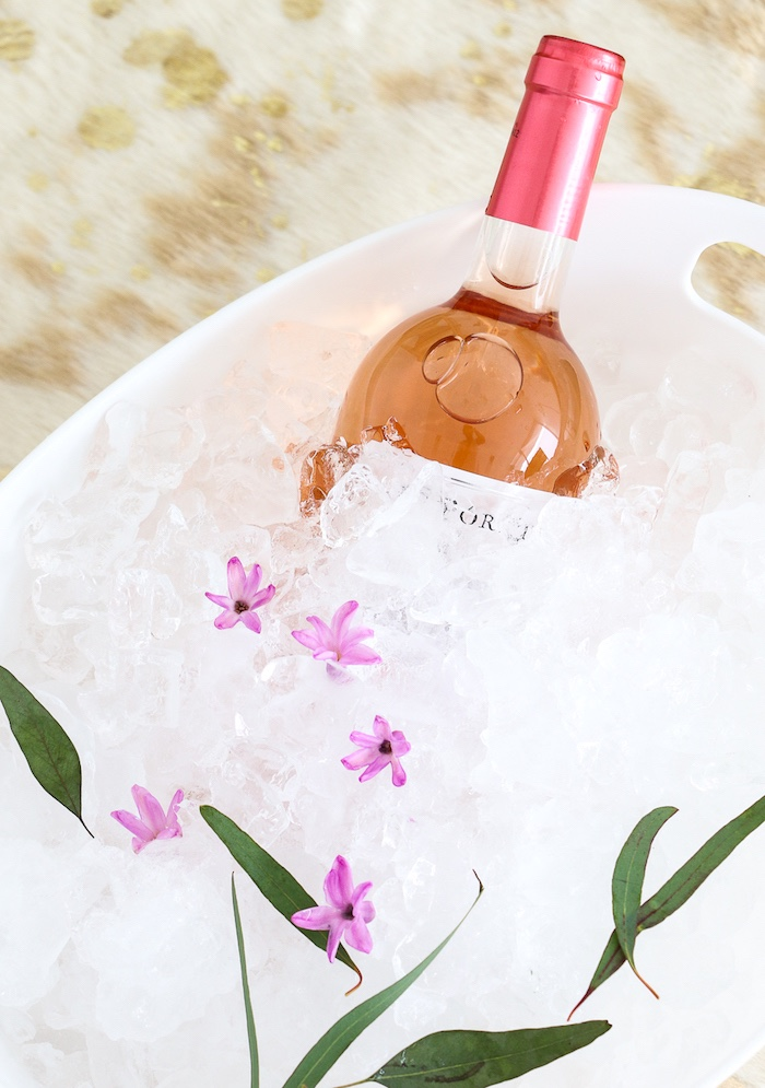 """Ice bucket filled with flowers from a """"Rosé All Day"""" Bridal Shower on Kara's Party Ideas 