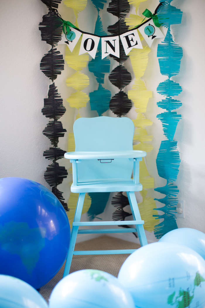 High chair with tissue garland backdrop from a 365 Days on Earth First Birthday Party on Kara's Party Ideas | KarasPartyIdeas.com (18)