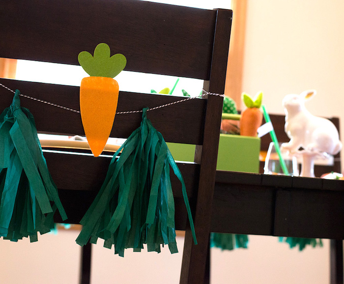 Carrot chair tassel from a Carrot Patch Easter Party with FREE Printables on Kara's Party Ideas | KarasPartyIdeas.com (10)