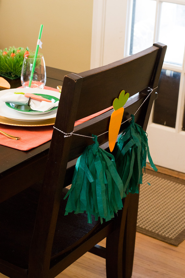 Easter chair tassels from a Carrot Patch Easter Party with FREE Printables on Kara's Party Ideas | KarasPartyIdeas.com (7)