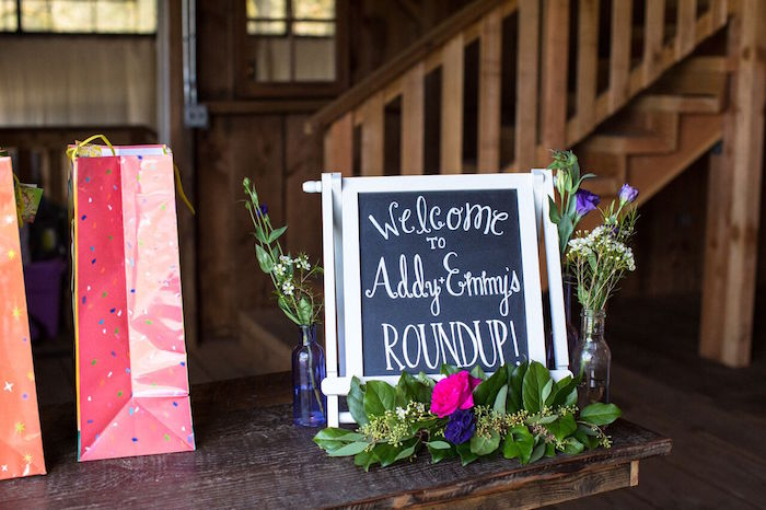 Flower adorned chalkboard sign from a Cowgirl Birthday Party Roundup on Kara's Party Ideas | KarasPartyIdeas.com (31)