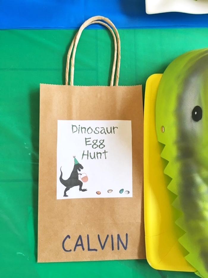 Dinosaur bag + place card from a DIY Dinosaur Birthday Bash on Kara's Party Ideas | KarasPartyIdeas.com (9)