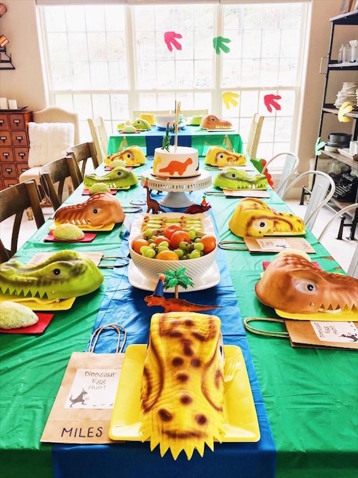 Dinosaur guest table from a DIY Dinosaur Birthday Bash on Kara's Party Ideas | KarasPartyIdeas.com (18)