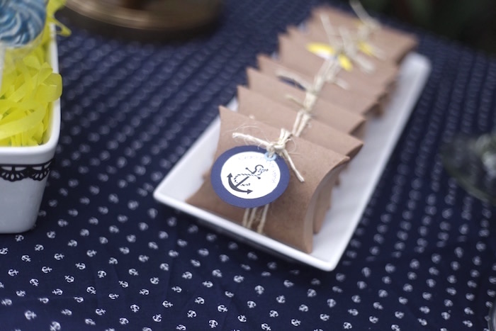 Pouch favor boxes tied with twine and anchor from a DIY Nautical 1st Birthday Party on Kara's Party Ideas | KarasPartyIdeas.com (4)