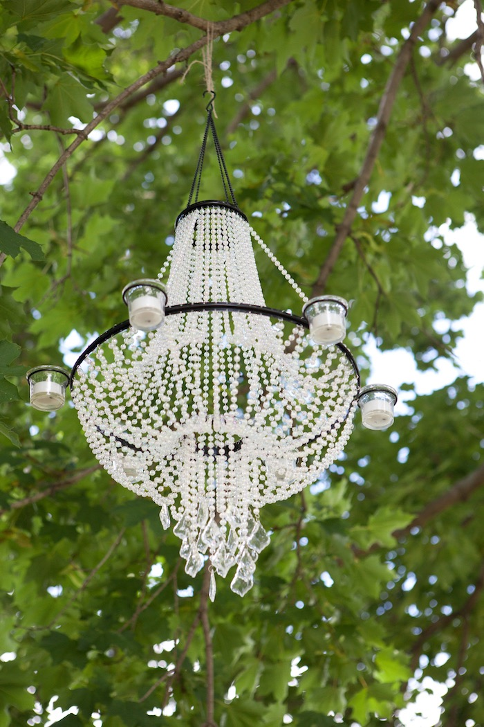 Crystal chandelier in the trees from an Elegant Parisian First Birthday Garden Party on Kara's Party Ideas | KarasPartyIdeas.com (17)