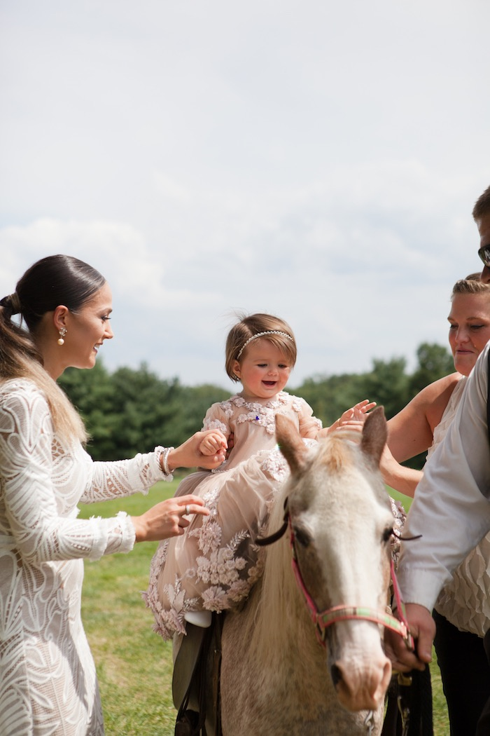 Horse ride from an Elegant Parisian First Birthday Garden Party on Kara's Party Ideas | KarasPartyIdeas.com (4)