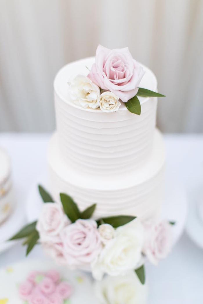 Two-tiered white cake from a Floral First Birthday Party on Kara's Party Ideas | KarasPartyIdeas.com (17)