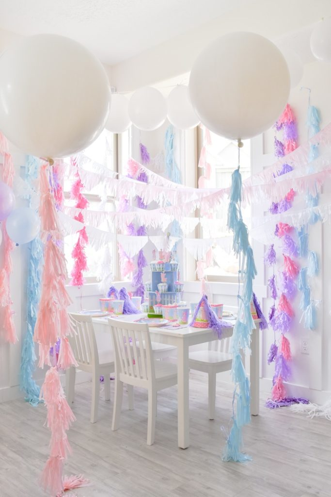 Large balloons and fringe tassels from the Little Llama First Birthday Party via Kara's Party Ideas