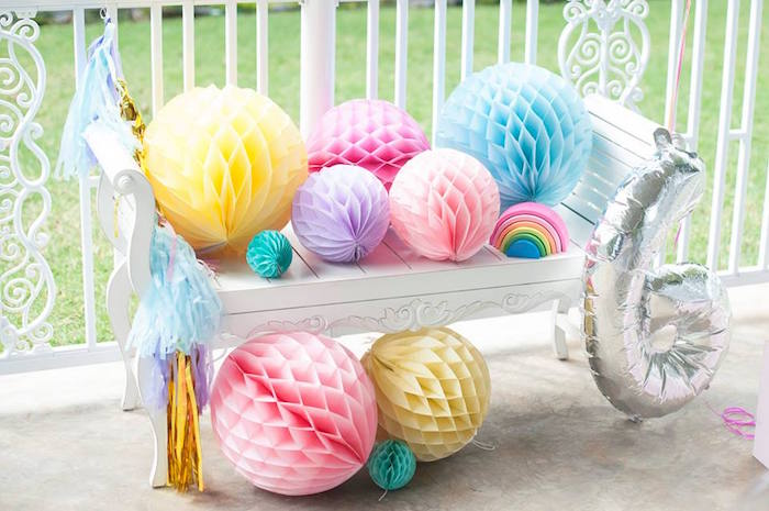 Bench full of tissue ball decorations from a Magical Unicorn and Rainbow Birthday Party on Kara's Party Ideas | KarasPartyIdeas.com (29)