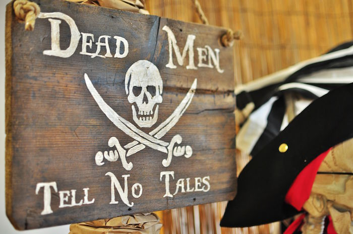 "Wooden ""Dead Men Tell No Tales"" Sign from a Pirates of the Caribbean Birthday Party on Kara's Party Ideas 