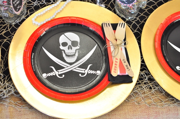 Crossbones place setting from a Pirates of the Caribbean Birthday Party on Kara's Party Ideas | KarasPartyIdeas.com (19)