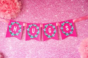 """Hugs"" banner from a Trolls Birthday Party with FREE Printables on Kara's Party Ideas 