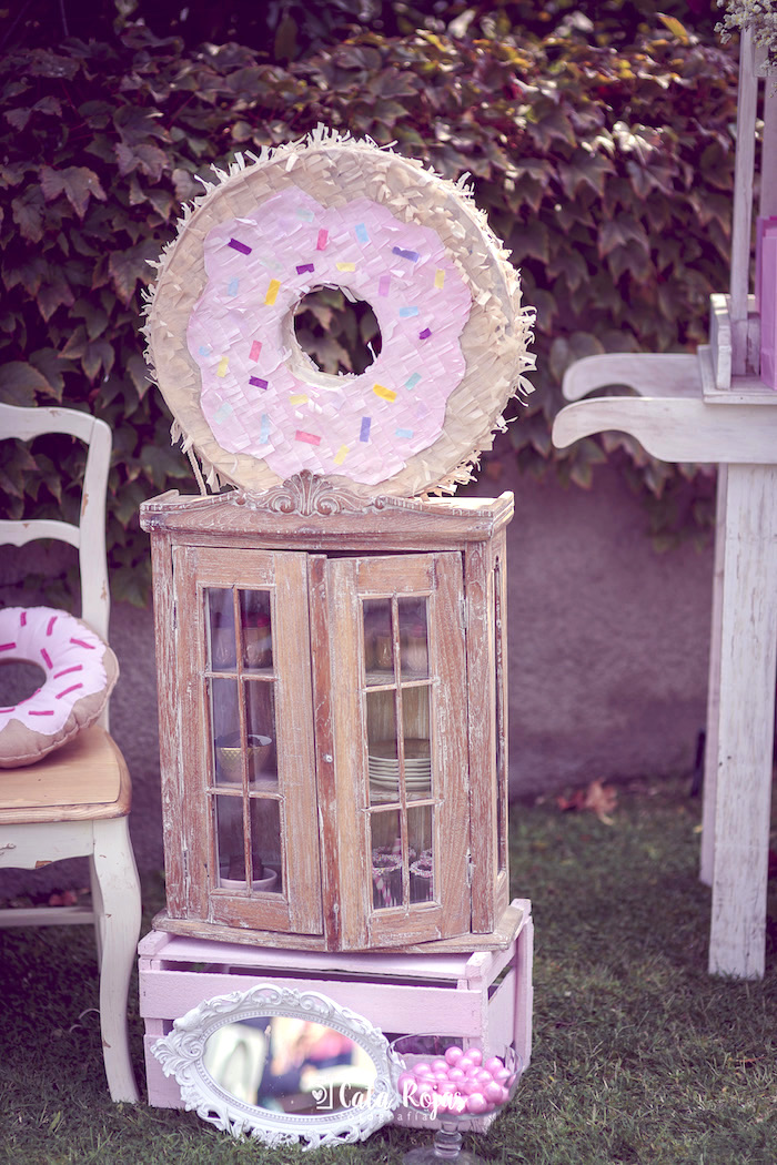 Rustic cabinet adorned with a donut pinata from a Vintage Donut Shop Birthday Party on Kara's Party Ideas | KarasPartyIdeas.com (29)