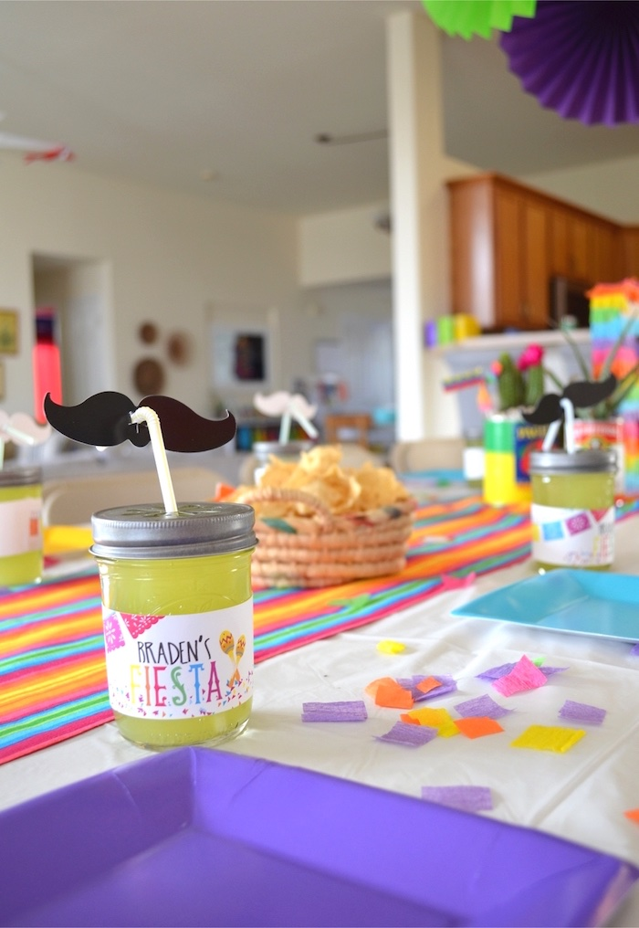 Crepe paper confetti + place settings from a Colorful Fiesta Birthday Party on Kara's Party Ideas | KarasPartyIdeas.com
