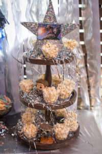 """Popcorn cups adorned with silver tinsel from a """"Guardians of the Galaxy"""" Birthday Party on Kara's Party Ideas 