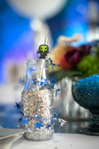 """Glitter dipped drink bottle wrapped in star twine from a """"Guardians of the Galaxy"""" Birthday Party on Kara's Party Ideas 