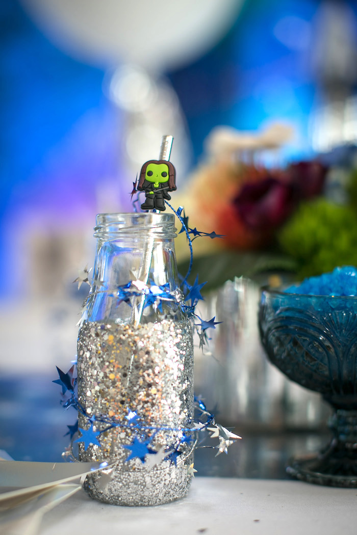 "Glitter dipped drink bottle wrapped in star twine from a ""Guardians of the Galaxy"" Birthday Party on Kara's Party Ideas 