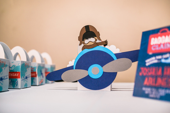 "Paper aviator centerpiece from a ""Time Flies"" Airplane Birthday Party on Kara's Party Ideas 