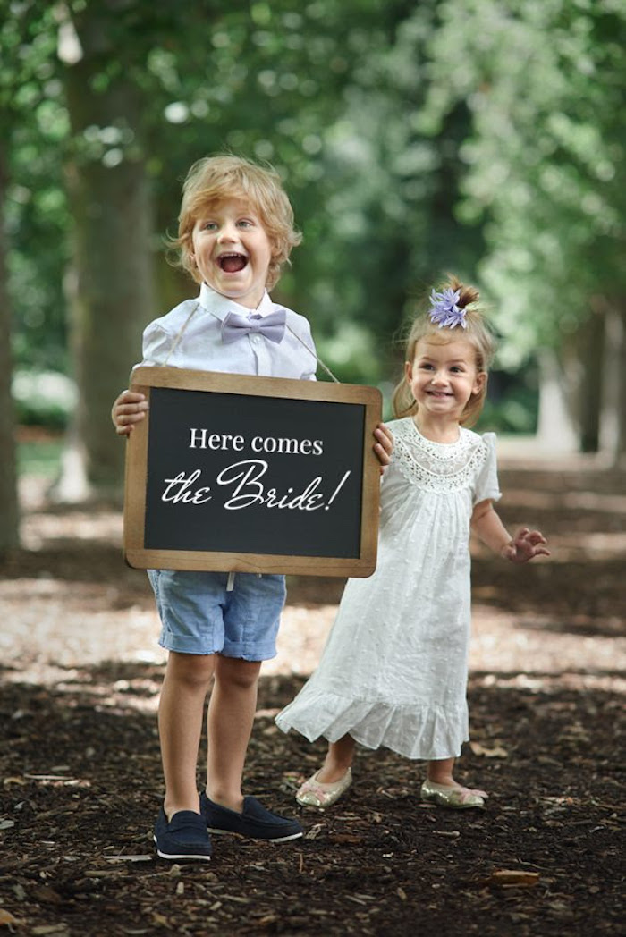 "Chalkboard ""Here Comes the Bride"" sign from a Boho Outdoor Wedding on Kara's Party Ideas 