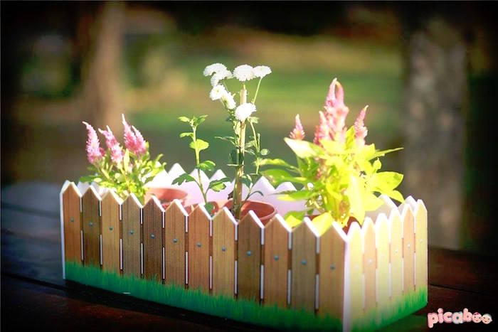 Picket fence garden centerpiece from a Peter Rabbit Garden Birthday Party on Kara's Party Ideas | KarasPartyIdeas.com (20)