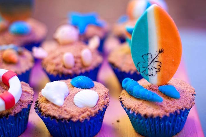 Surf board & shell cupcakes from a Surfing Birthday Party on Kara's Party Ideas | KarasPartyIdeas.com (20)