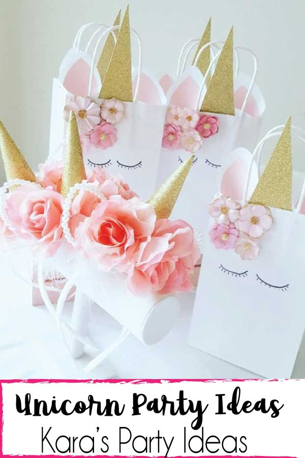 White unicorn goody bags and white unicorn headbands | Kara's Party Ideas