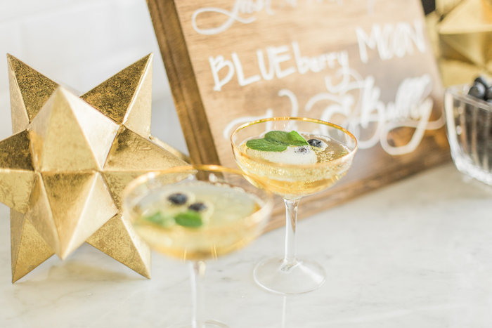 """Gold-rimmed drink glasses from a """"Love You to the Moon"""" Rustic Baby Shower on Kara's Party Ideas 