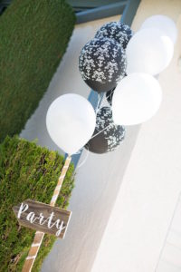Wooden arrow sign tied with balloons from a Boho Rustic Chic Engagement Party on Kara's Party Ideas | KarasPartyIdeas.com (43)