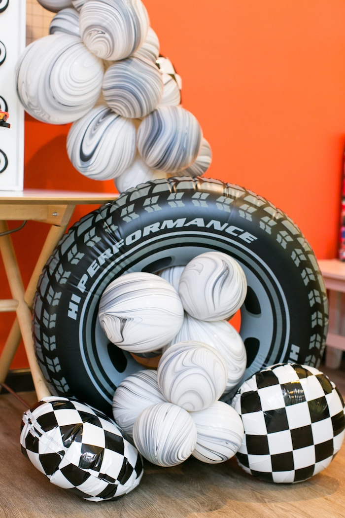 Balloons and tire decor from a Cars 3 Birthday Party on Kara's Party Ideas | KarasPartyIdeas.com (9)