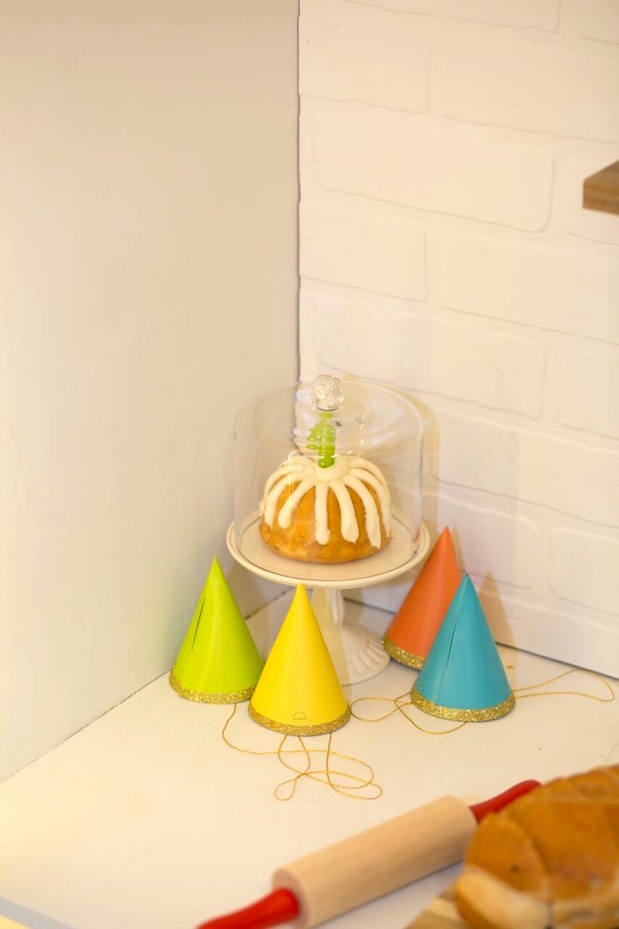 Bundt cake + party hats from a Little Town 1st Birthday Party on Kara's Party Ideas | KarasPartyIdeas.com (18)