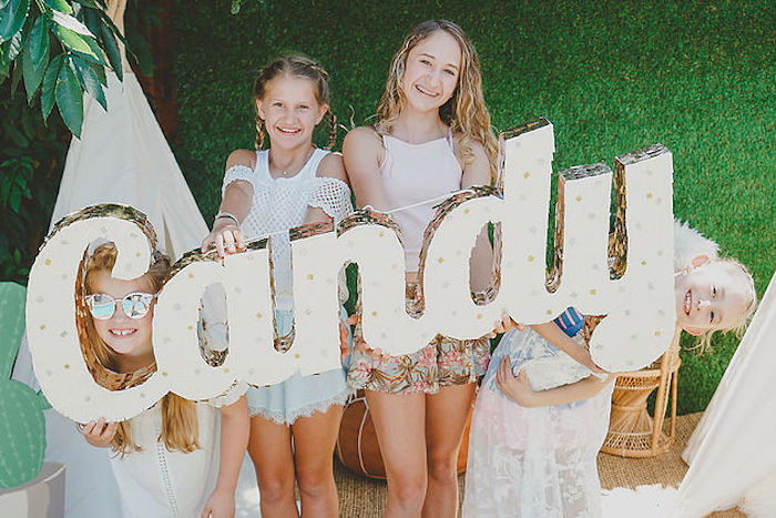 """Candy"" letter sign pinata from a Modern Hawaiian Moana Birthday Party on Kara's Party Ideas 