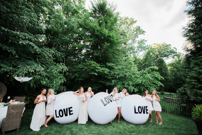 "Giant inflatable ""Love"" balls from a ""Love Your Tribe"" Ladies Luncheon Party on Kara's Party Ideas 