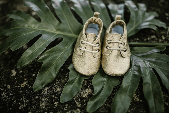 "Gold baby shoes from a ""Wild ONE"" Jungle Birthday Party on Kara's Party Ideas 
