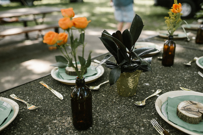 "Guest table centerpieces from a ""Wild ONE"" Jungle Birthday Party on Kara's Party Ideas 