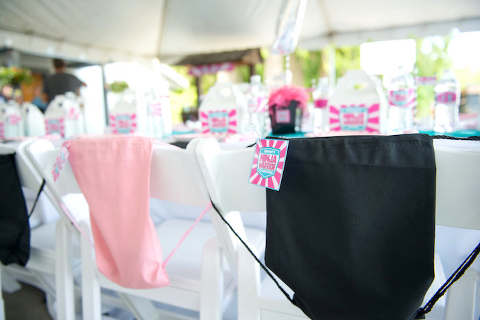 Guest chairs adorned with drawstring bags from an American Ninja Warrior Themed Birthday Party on Kara's Party Ideas | KarasPartyIdeas.com (43)