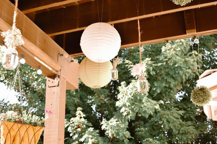 Hanging paper lanterns and jars of blooms from a Backyard Garden Baptism on Kara's Party Ideas   KarasPartyIdeas.com (20)