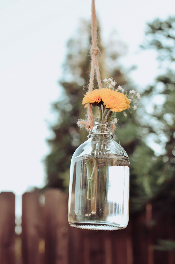 Suspended glass bottle blooms from a Backyard Garden Baptism on Kara's Party Ideas | KarasPartyIdeas.com (23)