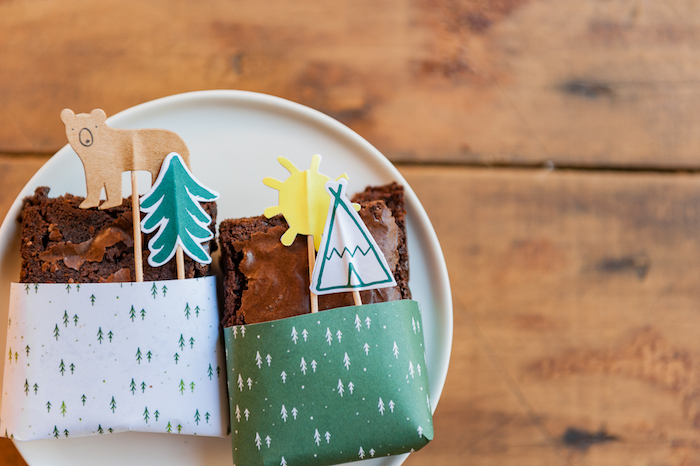 Brownies wrapped in white & green 'mini forest' wrapping paper from a Boho Winter Camping Sleepover Birthday Party on Kara's Party Ideas | KarasPartyIdeas.com (22)