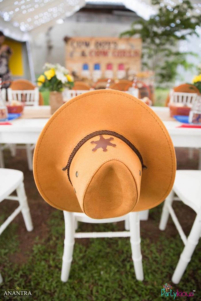 Cowboy hat draped over a guest chair from a Cowboys & Cowgirls Joint Birthday Party on Kara's Party Ideas | KarasPartyIdeas.com (31)
