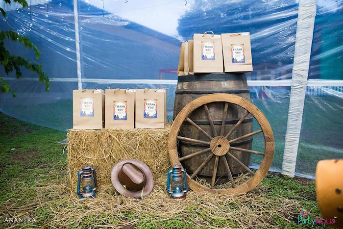 Wagon and barrel favor display from a Cowboys & Cowgirls Joint Birthday Party on Kara's Party Ideas | KarasPartyIdeas.com (20)