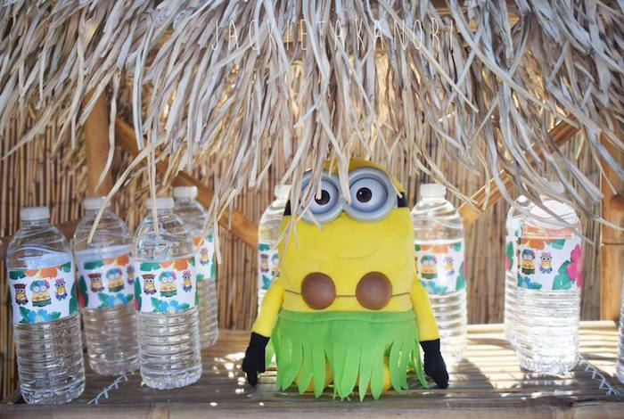 Water bottles under a straw umbrella table from a Despicable Me 3 Luau Party on Kara's Party Ideas | KarasPartyIdeas.com (12)